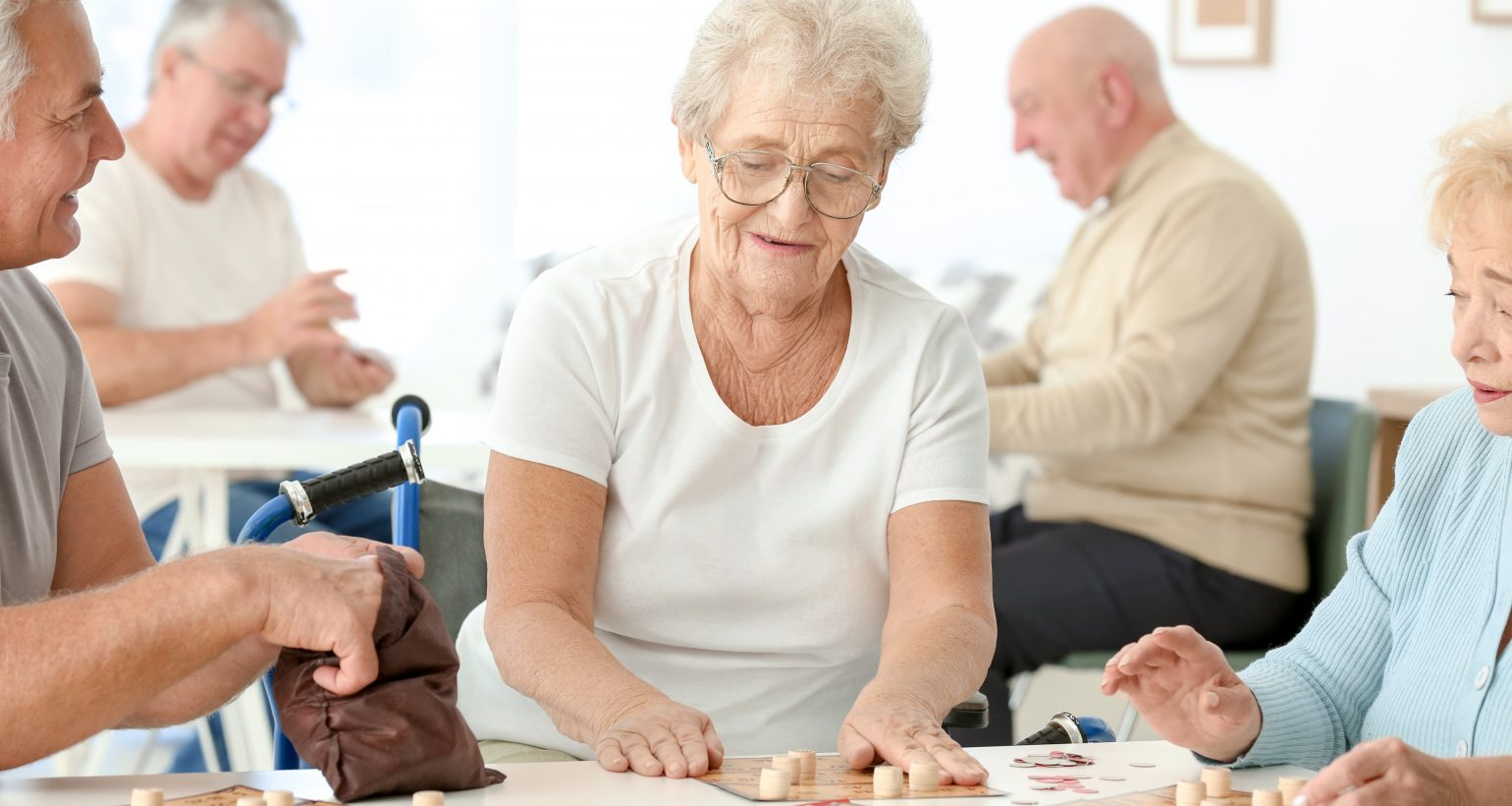 Senior people playing game at community center